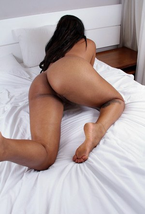 Back amateur Taiane gets naked on top of her bed before showing her pink pussy