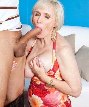 Busty nan Lola Lee seduces a younger man and rides his dick after a blowjob