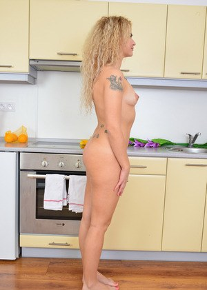 Solo model Angel Diamonds strips naked in kitchen before showing her pink twat