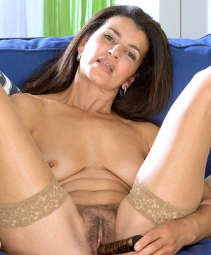 Older MILF Georgina masturbates her bush wearing tan nylons