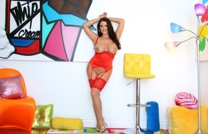 Curvy brunette female Angela White releases her huge boobs from red lingerie