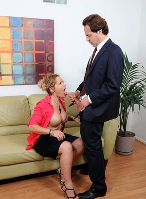 Horny mature woman Kelly Leigh unzips her guy's pants and sucks and fucks him