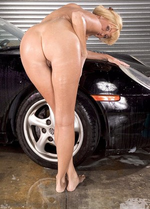 Mature pornstar Penny Porsche takes a break from car washing to bare her boos