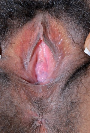Black chick Kimmy Katt shows off her hairy muff for the first time