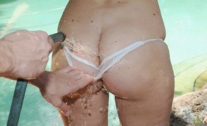Solo girl Dani Lane wet her sheer panties with a garden hose
