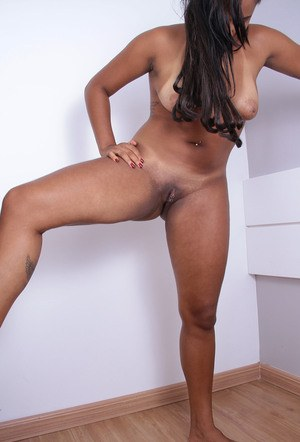 Curvy black chick Taiane sheds her short dress to pose nude for first time