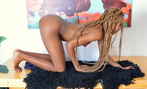 Black amateur with corn braids shows the pink of her moist pussy