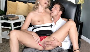 Hot middle-aged blonde Valerie Rose seduces a coworker wearing a tight dress