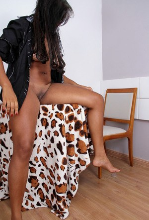 Black female Taiane shows off her shaved pussy in the nude for the first timer