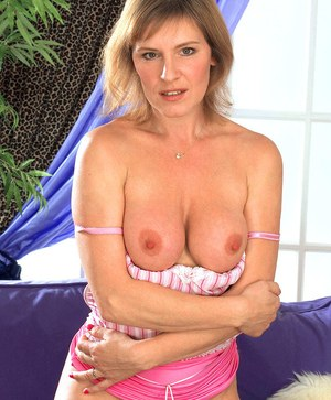Mature housewife Wendy bares her big tits while playing with her pussy