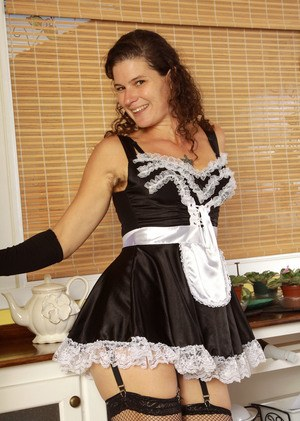 Mature maid Sunshine spreads her mesh hose clad legs to air out her hairy twat