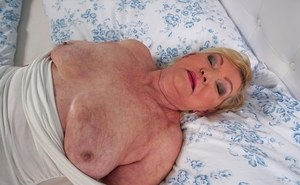 Thick grandmother Irene bares her saggy boobs before showing her hairy muff