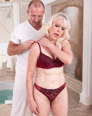 Hot blonde granny Lady S seduces her masseur in red bra and panty set