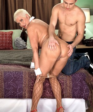 Hot grandmother with short hair seduces her boy toy in fishnet stockings