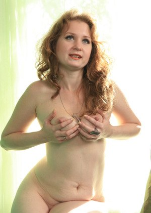 Older model Mandy proudly shows off her bald pussy after a slow stripteae