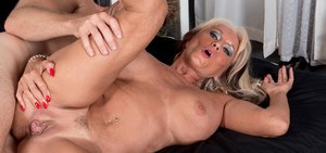 Big boobed granny Sally D'Angelo seduces a younger man for a wild sex romp