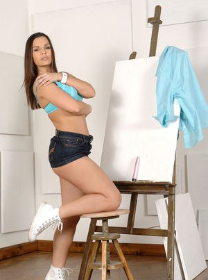 Hot MILF Eve Angel uncovers in firm breasts in a denim miniskirt