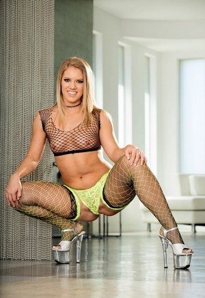 Sexy blonde model Candice Dare rocks her big ass in sexy fishnet stickings