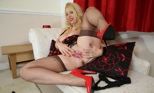 Mature blonde lady Lucinda showcases her pussy in RHT nylons and garters