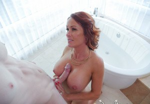 Redhead cougar Sabrina Cyns pleases the neighbor's boy with a BJ and tit fuck
