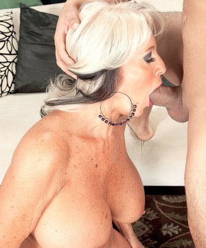 Big boobed granny Sally D'Angelo sucks off her boy toy's cock with gusto