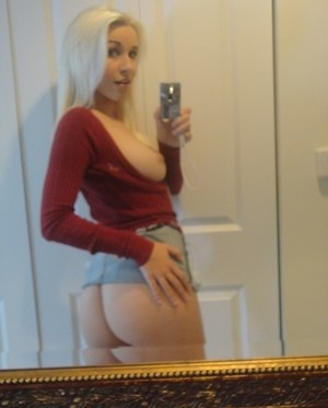 Hot blonde teen Stevie Shae takes selfies of her firm tits in the mirror