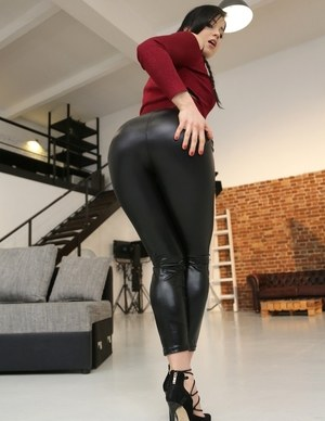 Dark haired solo model Taissia Shanti slips out of her black leather pants