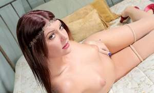 Solo girl Cassandra Nix rocks the hippy look as she undresses in her bedroom