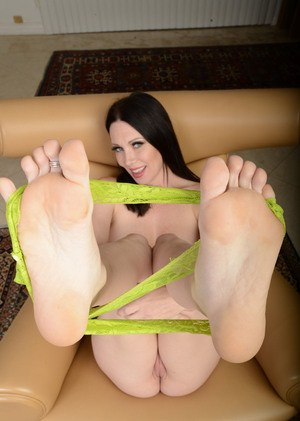 Brunette MILF RayVeness goes barefoot while putting on a cam show on a chair
