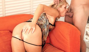 Older blonde woman Crystal Jewels sucks a young boy for a mouthful of cum