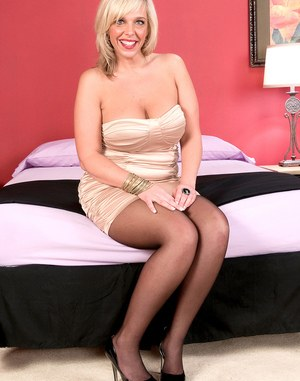 Older blonde divorcee Carey Riley shows off her twat with her legs wide open