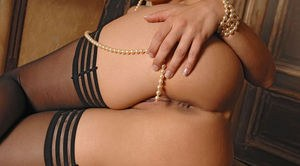 Gorgeous MILF Eve Angel teases her perfect pussy with her pearl necklace