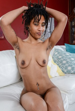 Skinny black chick Indie Cass spreads her hairy bush wide open