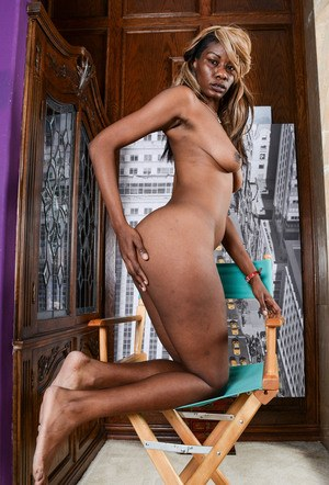 Black amateur Ebony Desire undresses before showing the pink of her pussy