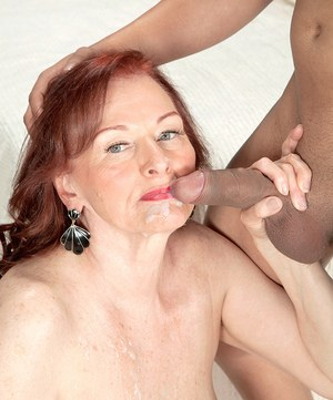 Redhead grandmother Katherine Merlot bangs her boy toy in tan colored nylons