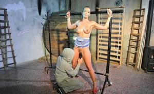 Clothed chick Nicole Vice is tied up and masturbated with her tits now exposed