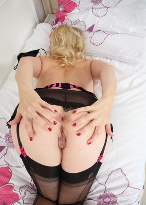 Older blonde woman Lucinda flaunts her goods in hot lingerie and hose combo