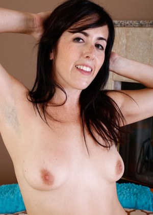 Brunette MILF Dixie Comet frees her all natural pussy from her panties