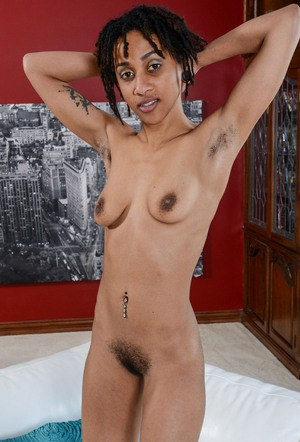 Black amateur Indie Cass is all smiles while showing her pink twat in the nude