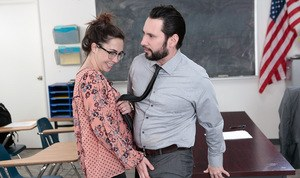 Glasses wearing schoolgirl Geneva King seduces her teacher for sex on his desk