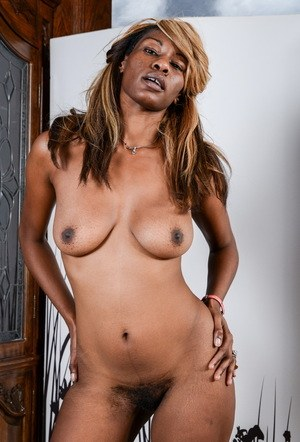 Black chick Ebony Desire models in the nude for the first time