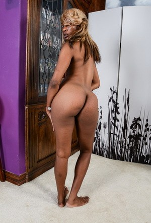 Black amateur Ebony Desire parts her pussy lips after doffing shorts and shirt