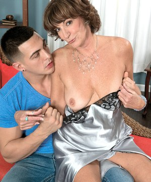 Hot granny Sydni Lane seduces a younger man wearing satin lingerie