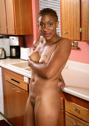 Older black lady Donni shows off her pink pussy for the first time