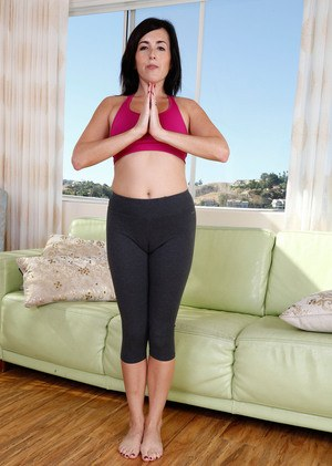 Dark haired middle-aged lady showcases her hairy muff after a yoga session