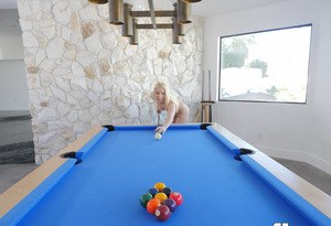 Blonde chick slides off purple leggings while shooting a game of pool