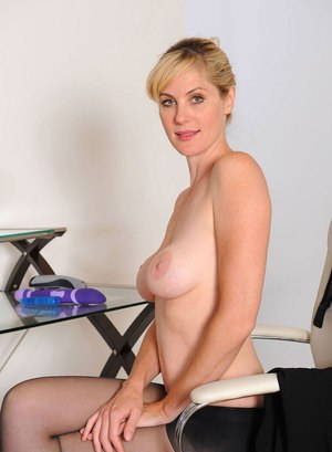 Blonde lady Kate Kastle lets her hair down and strips before masturbating