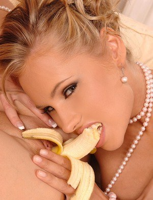 Beautiful blondes share a banana and a banana styled vibrator as well