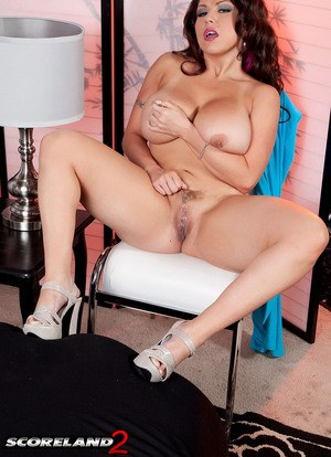 Sexy MILF Sheridan Love exposes her knockers and pierced nipples as she strips