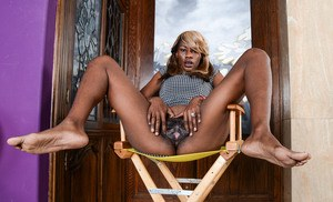 Black first timer Ebony Desire hikes her dress up to display her hairy snatch